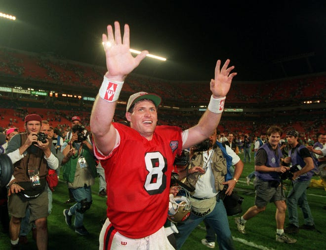 Steve Young celebrates while a member of the Super Bowl-winning 1994 San Francisco 49ers. Young, who played quarterback for BYU, headlines this hypothetical roster of all-time NFL greats who had ties to Utah.