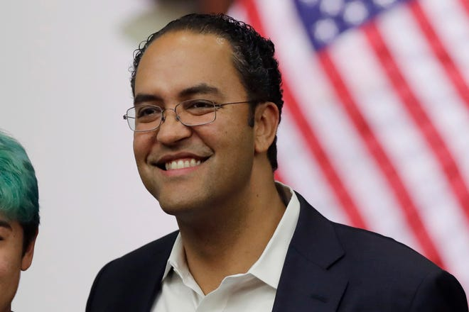 FILE - In this Oct. 23, 2019, file photo, Rep. Will Hurd, R-Texas, right, poses for photos at the Texas A&M-San Antonio. Hurd announced on Aug. 1, 2019, he will not seek reelection in 2020. (AP Photo/Eric Gay)