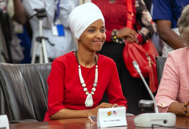 "Rep. Ilhan Omar, one of the delegation lead by US House Speaker Nancy Pelosi, looks on Ghana's Parliament in Accra, Ghana, Wednesday, July 31, 2019. U.S. House Speaker Nancy Pelosi is in Ghana as the head of a Congressional delegation to address Ghana's lawmakers on Wednesday. While in Ghana, Pelosi and other members of the U.S. Congress plan discussions on ""regional security, sustainable and inclusive development and the challenges of tomorrow including the climate crisis."" (AP Photo/Christian Thompson)"