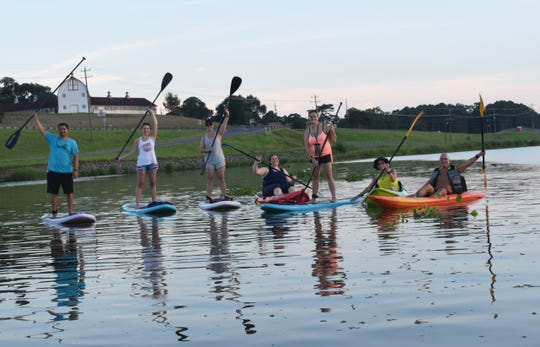 James Waight (far left), former owner of River Paddle Rentals along with wife Karen Waight, hosted a paddling meet-up at Lake Buhlow in Pineville last year.