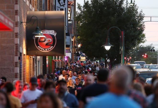College Avenue fills with people during Day 2 of the 7th annual Mile of Music Festival Friday, Aug. 2, 2019, in Appleton, Wis.