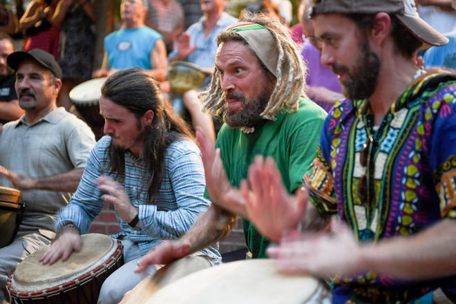 Ashevillans mingled with visitors as they danced and joined the drum circle for a crowd of spectators at Pritchard Park August 2, 2019.