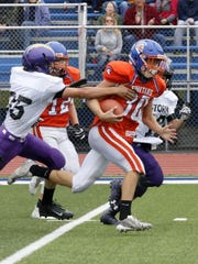 Unadilla Valley defenders try to coral a Thomas A. Edison ballcarrier.