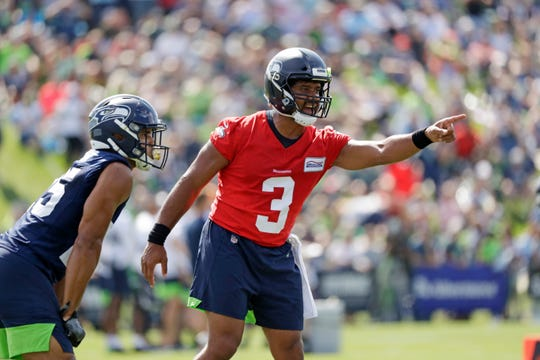Seattle Seahawks quarterback Russell Wilson missed Friday's practice while attending his grandfather's funeral.