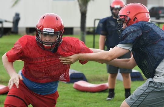 Cocoa Beach football players prepare for their first game of the season Aug. 16. The Minutemen will travel to