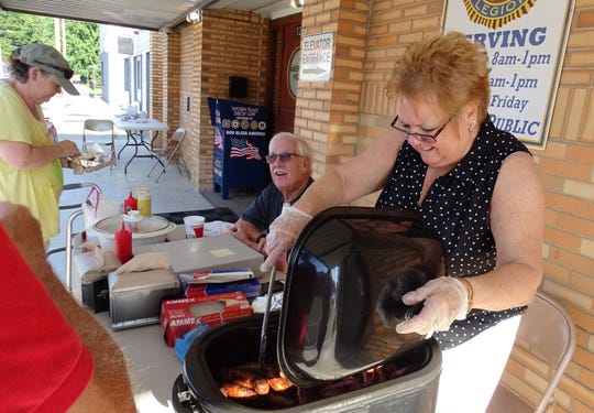 Bratwursts and hot dogs were served up in front of the American Legion Hall on East Rensselaer Street during the August 2019 First Friday event downtown.