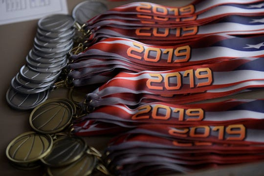 Hoops for Homeless medals sit on a table, Saturday, Aug. 3, 2019. Seven thousand dollars was raised before the event.