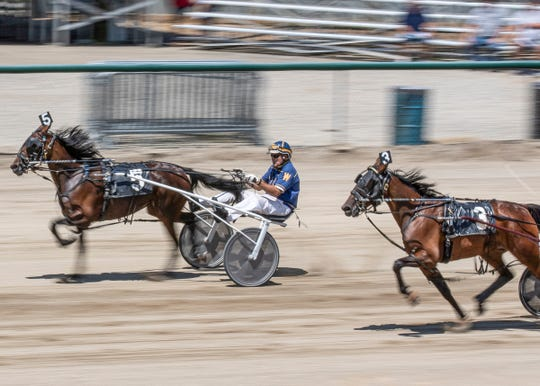 Susie D, driven by Bryan Weaver, races past Annie Da, driven by Ry Holton, to win the fifth harness race of the day with a time of 31 seconds. The first day of the Ross County Fair introduced day one of harness racing on August 3, 2019, and will continue Sunday. The races are based on age, sex, and gate.