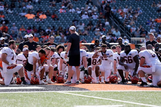 Cincinnati Bengals head coach Zac Taylor addresses the team at the end of practice during Cincinnati Bengals training camp practice, Saturday, Aug. 3, 2019, at the practice fields next to Paul Brown Stadium in Cincinnati.