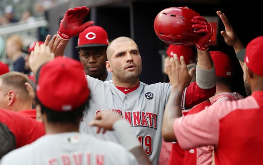 Aug 2, 2019; Atlanta, GA, USA; Cincinnati Reds first baseman Joey Votto (19) celebrates his two run home run with teammates in the dugout during the first inning against the Atlanta Braves at SunTrust Park. Mandatory Credit: Jason Getz-USA TODAY Sports