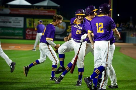 Johnston celebrates a run during their 4A state baseball semi-final game on Friday, Aug. 2, 2019 in Des Moines. Johnston would go on to defeat Dowling Catholic 7-0 to advance to the finals on Saturday.
