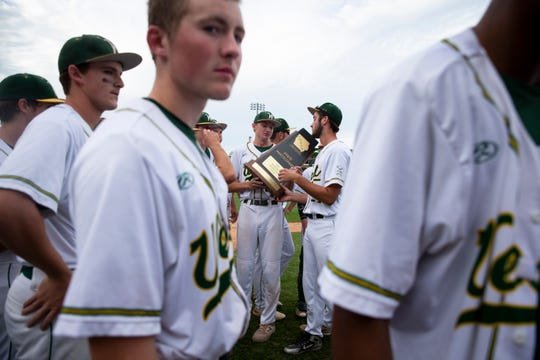Iowa City West accepts their state participant trophy after loosing 2-10 during their 4A state baseball semi-final game to Urbandale on Friday, Aug. 2, 2019 in Des Moines.