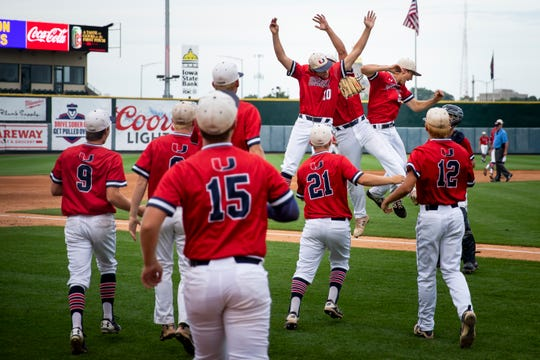 Urbandale celebrates its 10-2 4A state baseball semi-final victory over Iowa City West on Friday, Aug. 2, 2019 in Des Moines.