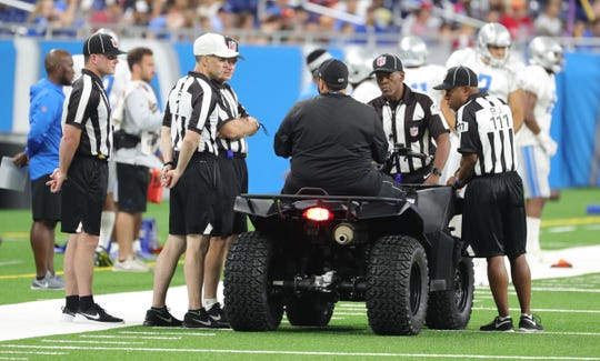 Detroit Lions head coach Matt Patricia talks with officials while on his ATV Friday, August 2, 2019 at Ford Field.