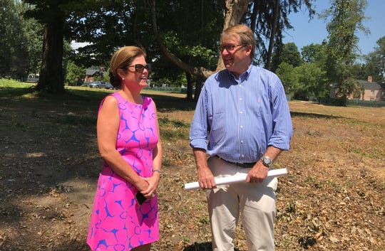Jennifer Peck, part owner of 8 acres in Grosse Pointe Shores, views the site on Aug. 2 with her husband, homebuilder Richard Russell.