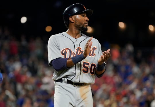 Detroit Tigers right fielder Travis Demeritte celebrates as he scores a run against the Texas Rangers during the ninth inning August 2, 2019 in Arlington, Texas.