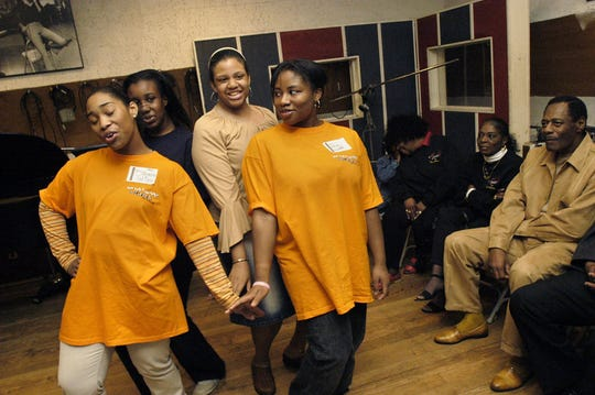 "Members of the original Mosaic cast of ""Now That I Can Dance -- Motown 1962"" rehearse at the Motown Museum in 2005. l"