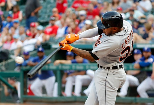 Detroit Tigers' Harold Castro hits an RBI single in the first inning against the Texas Rangers in Arlington, Texas, Friday, Aug. 2, 2019.