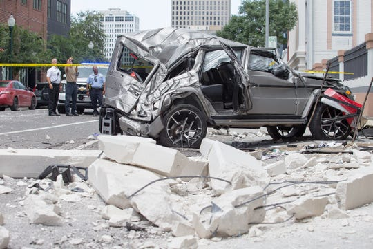 A Mercedes SUV plunged from the fourth floor of a parking garage onto O'Keefe Ave. in New Orleans, July 15, 2018.