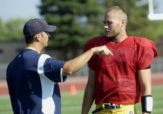 Augustana College quarterback Luke Butler talks with head coach Brad Salem in 2008 in Sioux Falls, South Dakota.  (Elisha Page/Argus Leader)
