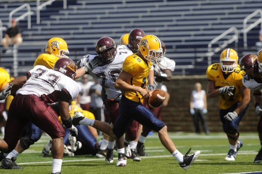 Augustana's Tyler Schulte runs the ball into the endzone for a touchdown in 2009, when Brad Salem's offense scored 30.2 points a game. (Lara Neel/Argus Leader)