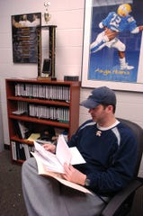 Brad Salem looks through a stack of signed letters of intent in 2008 at Augustana College in Sioux Falls, South Dakota.