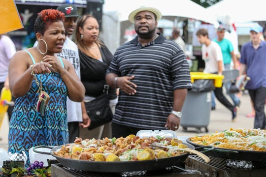 Ribs and all the fixings compete with music for visitors' attention at the Ribs R&B Music Festival.