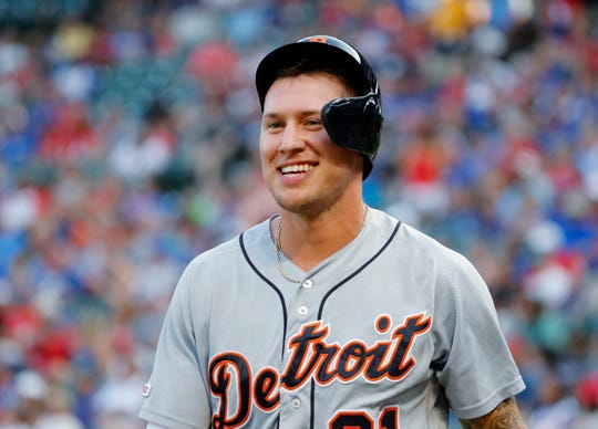 Detroit Tigers' JaCoby Jones smiles as he walks to the dugout after scoring during the first inning against the Texas Rangers in Arlington, Texas, Friday, Aug. 2, 2019.
