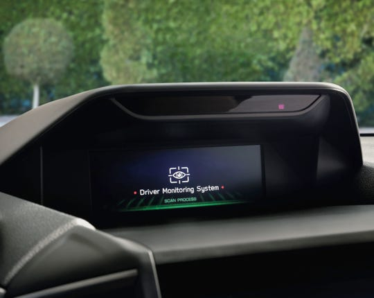 A message from the facial recognition system in a 2019 Subaru Forester. The infrared camera that monitors drivers is behind the glass screen.