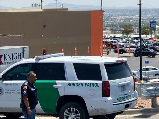 Law enforcement work the scene of a shooting at a shopping mall in El Paso, Texas, on Saturday.