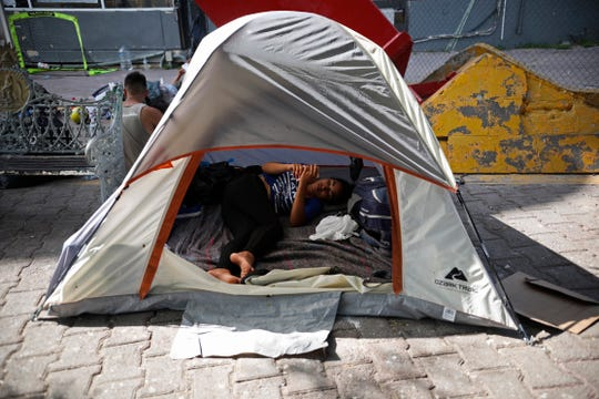 A migrant rests inside a tent pitched near a Mexican immigration center where people have set up camp to sleep in Matamoros, Mexico, Thursday, Aug. 1, 2019, on the border with Brownsville, Texas. The United States government has sent some 800 mostly Central American and Cuban immigrants back to this northern Mexico border city since expanding its controversial plan to this easternmost point on the shared border two weeks ago, according to local Mexican authorities.