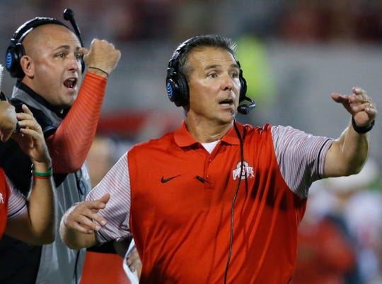 Ohio State coach Urban Meyer, right, encouraged Zach Smith, left, to stay with the Buckeyes in January 2018 after the then-assistant coach was pursued by Alabama, according to texts messages from Meyer to Smith.