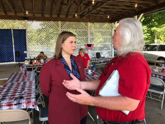 Rep. Elissa Slotkin, D-Michian, talks with a constituent after a veterans event on Friday, at the Ingham County Fair in Mason. Slotkin, who flipped the 8th Congressional District by defeating a Republican incumbent in 2018, has not backed an impeachment inquiry of President Donald Trump.