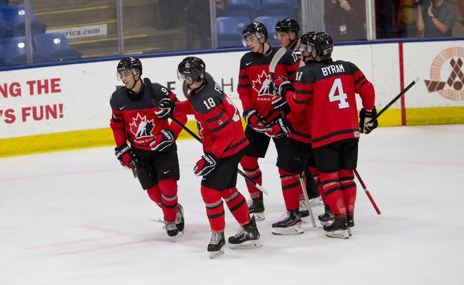 Red Wings draft pick Joe Veleno, left, celebrates a goal against the U.S. on Tuesday at the World Junior Summer Showcase in Plymouth.