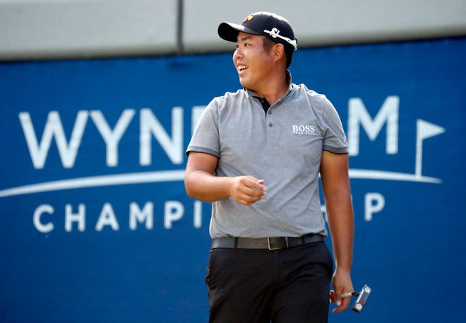 Byeong Hun An smiles on the 17th hole during the third round of the Wyndham Championship Saturday.