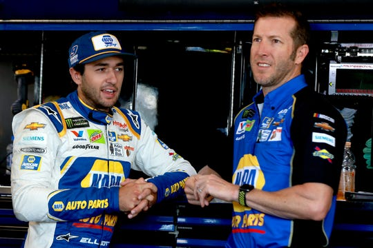 Chase Elliott stands in the garage with crew chief Alan  Gustafson during practice for the Monster Energy NASCAR Cup Series Go Bowling at The Glen at Watkins Glen International on Aug. 3, 2019.