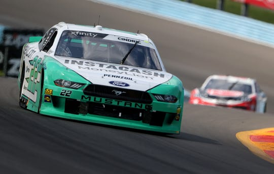 Austin Cindric, driver of the #22 MoneyLion Ford, leads a pack of cars during the NASCAR Xfinity Series Zippo 200 at The Glen at Watkins Glen International on Aug. 3, 2019.