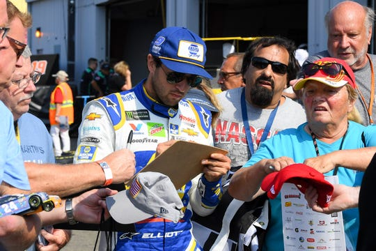 Chase Elliott signs autographs prior to practice for the Go Bowling at The Glen at Watkins Glen International on Aug. 3, 2019.