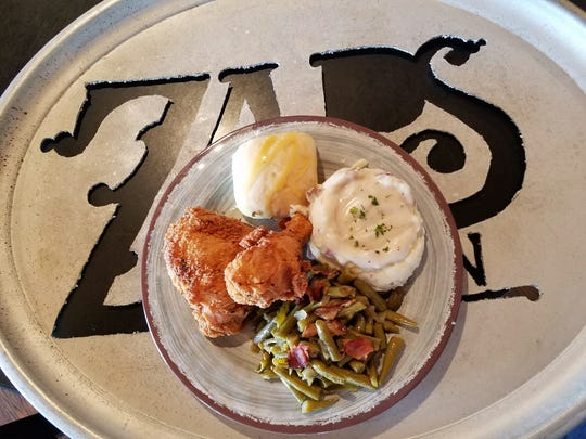 Fried chicken dinner with mashed potatoes, country gravy and green beans with bacon at Zaps Tavern.