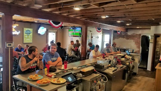 Patrons gather in the new bar room at Zaps Tavern on Wednesday, July 24, 2019.