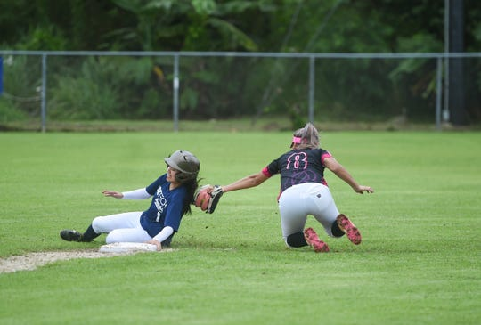 Adztech's Sherika Cabrera (1) slides to second base on a play against the Queen B's during an APL Women's Fastpitch Softball League game at the Mike S. Tajalle Baseball Field in Piti, Aug. 3, 2019.