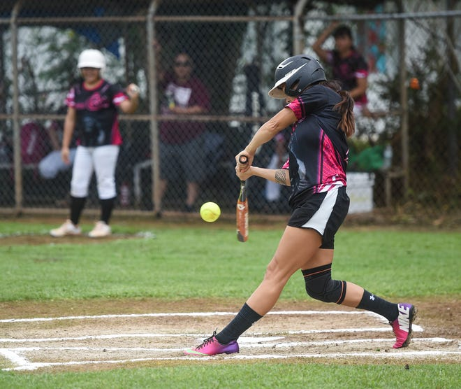 In this file photo from Aug. 3, Queen B's catcher Ray Acfalle connects on a pitch by Meagan Maratita in APL Women's Fastpitch Softball League action at the Mike S. Tajalle Baseball Field in Piti, Aug. 3, 2019.
