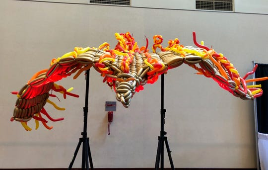 Balloon artist Tim Thurmond created this phoenix balloon sculpture this weekend at Gen Con.