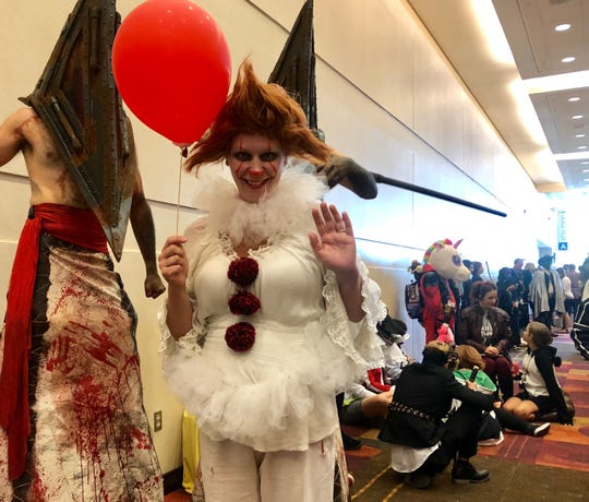 """Mandy Buxrude traveled from Wisconsin to attend Gen Con. On Saturday, she showed off her Pennywise outfit from the movie """"It."""""""