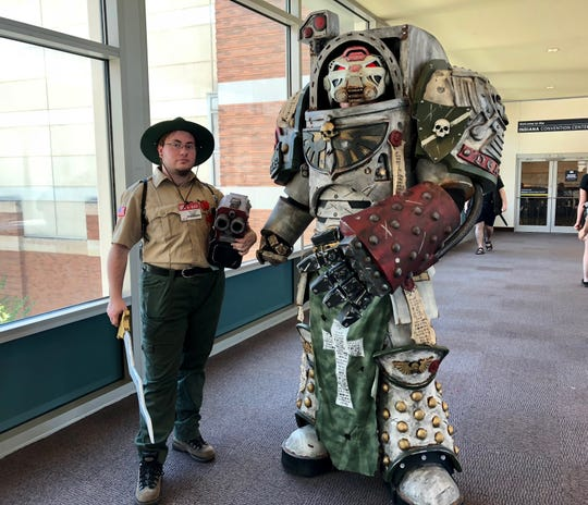 """Adden Truesdale, left, attended Gen Con dressed as Duck Newton from the podcast """"The Adventure Zone."""" Jerry Rowe came as a terminator from the tabletop game Warhammer 40,000."""