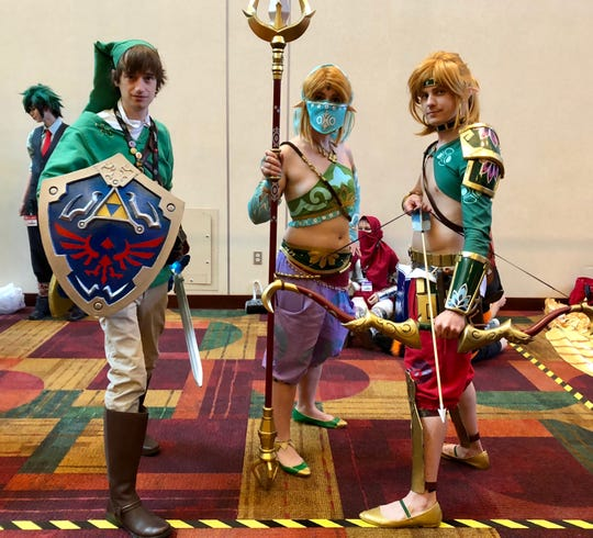 """Andrew Liden, Dannielle Wentzel and Daniel Wentzel dressed up as three variations of the character Link from """"The Legend of Zelda."""""""