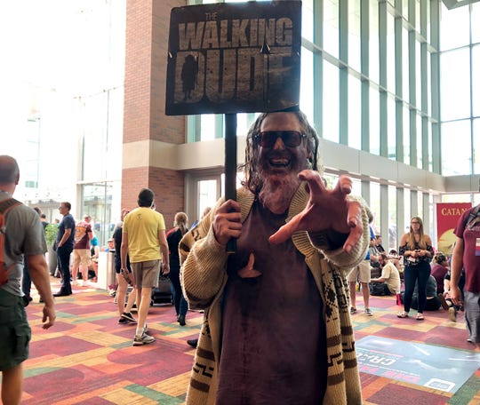 """Mark Stafford came to Gen Con from Dayton, Ohio, to show off his costume that's a mashup of """"The Big Lebowski"""" and """"The Walking Dead."""""""