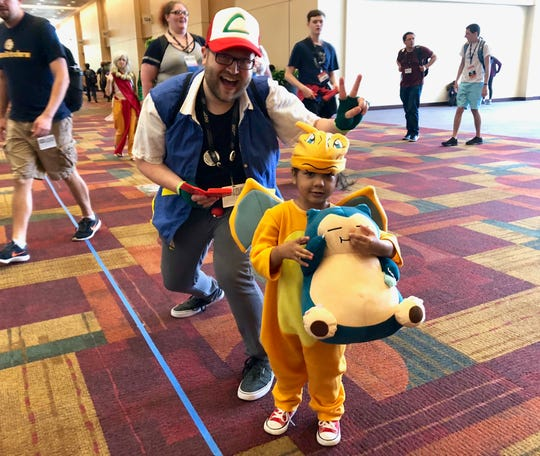 This father and son duo attended their first Gen Con dressed as characters from Pokémon.