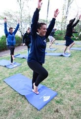 Executive Director of A-GAP Bethany Baker does yoga with a group who is on a retreat with the company to form a healthy relationship with social media and living life in the moment.
