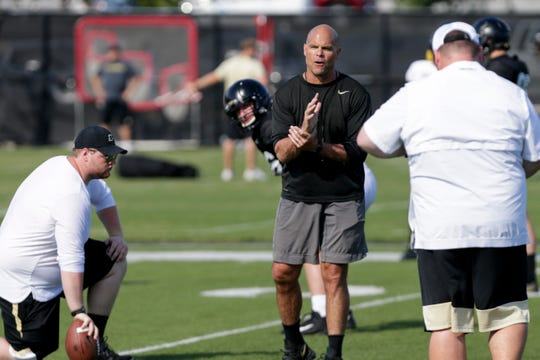 Purdue assistant coach Nick Holt calls out a play during practice, Saturday, Aug. 3, 2019 at Bimel Practice Complex in West Lafayette.